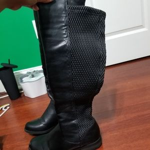 Black knee high boots with stretchy fit